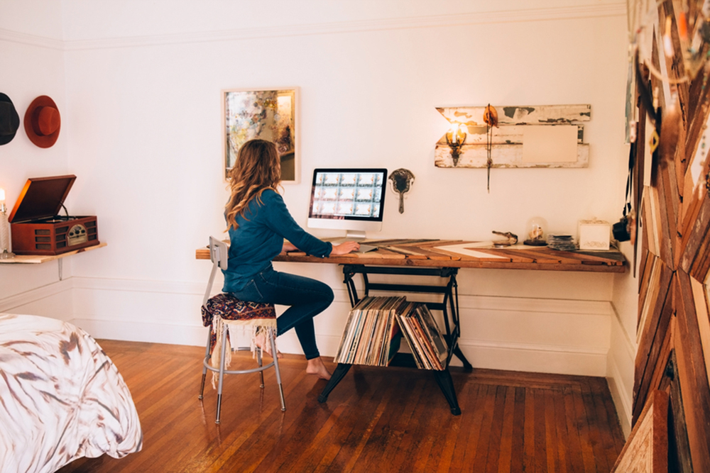 may2015-trulia-7-ways-to-rethink-your-underused-rooms-woman-at-home-office